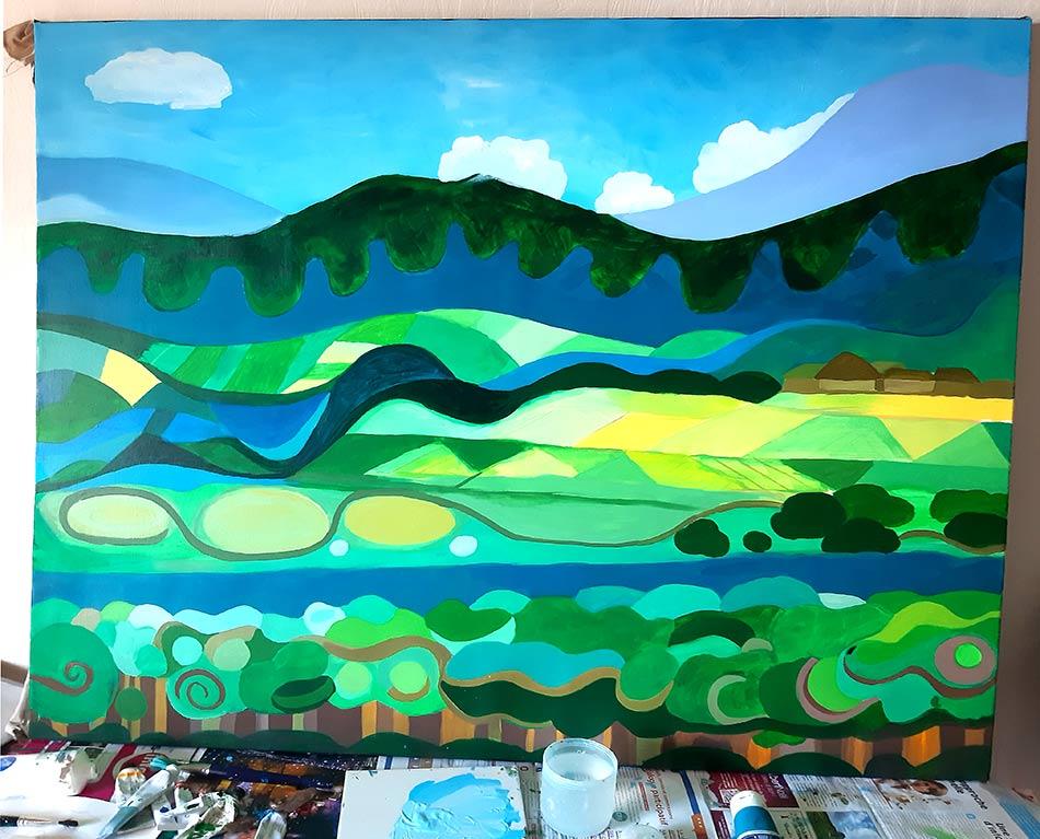 Cielo, nubes, montes y cultivos